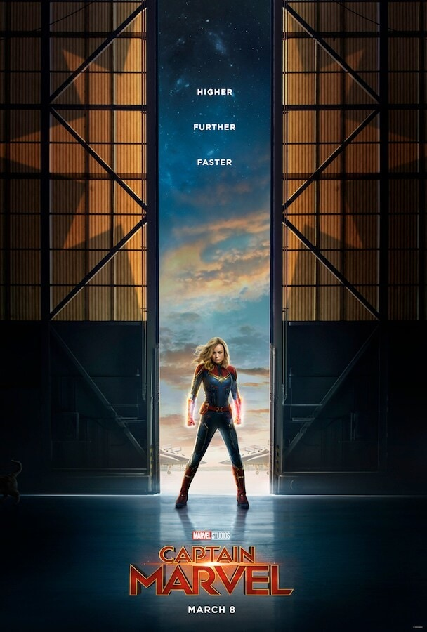 Marvel Studios Captain Marvel March 8 Captain marvel in front of a hangar, hands glowing with cosmic power
