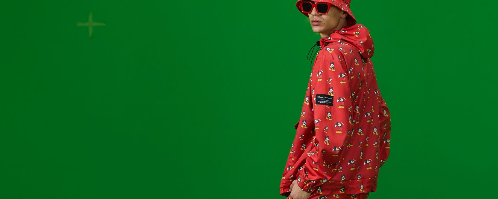 Disney and BoohooMAN clothing on a model