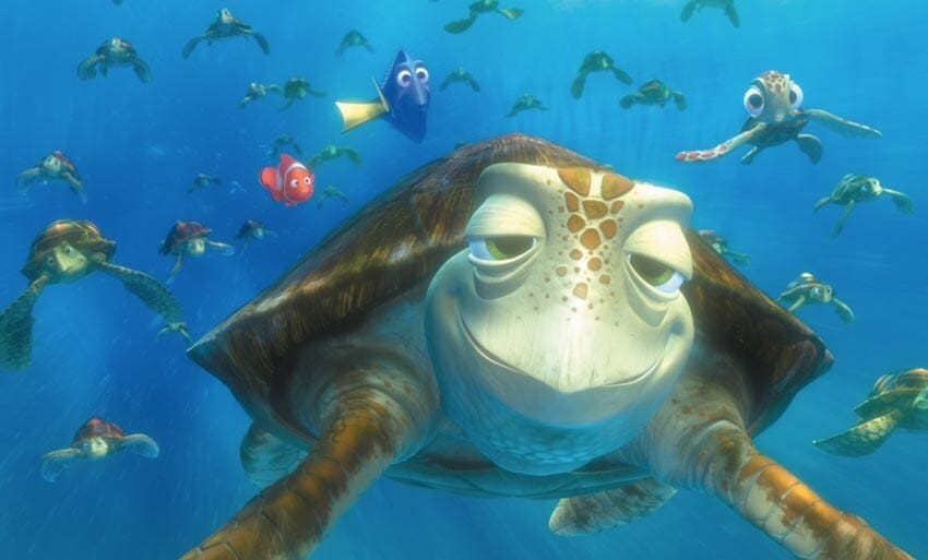 """Nemo and Dory swimming with Crush and the other sea turtles in the animated movie """"Finding Nemo"""""""