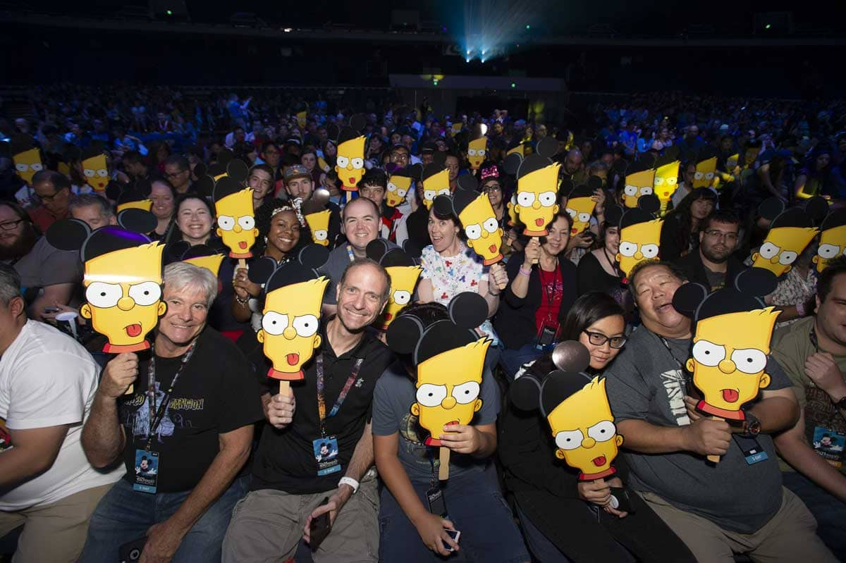 Audience wears Bart Masks