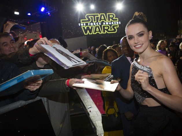 Daisy Ridley, Rey in The Force Awakens, signs autographs for fans at the European premiere of the...
