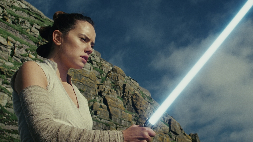 Rey with a lightsaber
