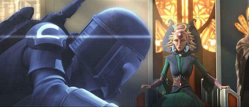 Satine Kryze observing a hologram of a Mandalorian warrior