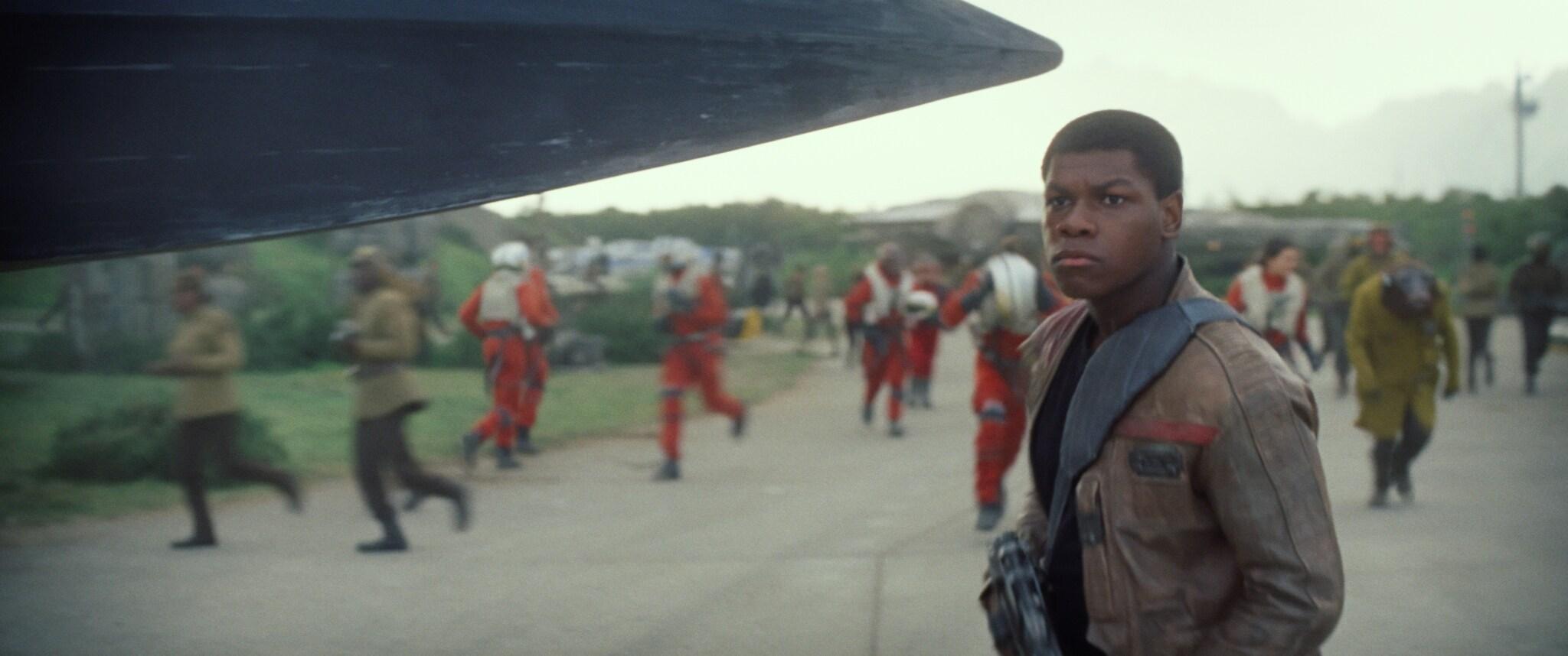 John Boyega as Finn standing in front of Resistance soldiers.