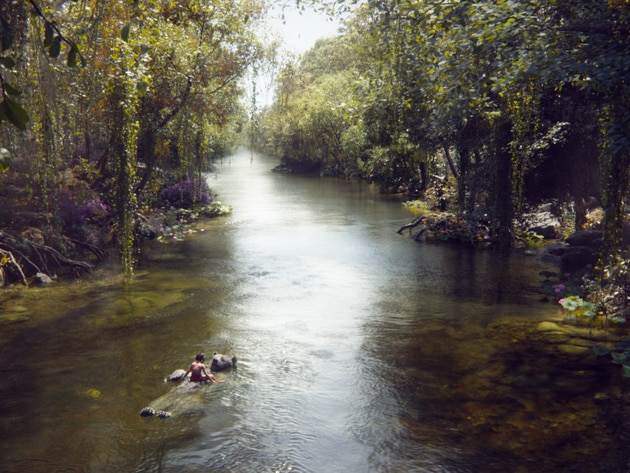 Mowgli (newcomer Neel Sethi) and Baloo (voice of Bill Murray) float down a river in The Jungle Bo...