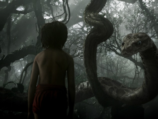 Mowgli (newcomer Neel Sethi) meets Kaa (voice of Scarlett Johansson) in The Jungle Book, an all-n...
