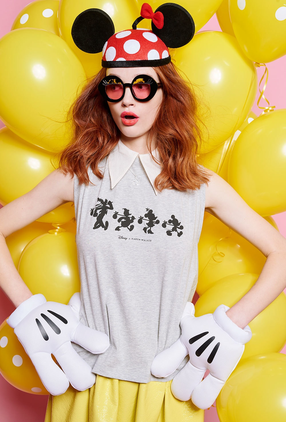 Model wearing products from the limited edition Disney x Karen Walker collection