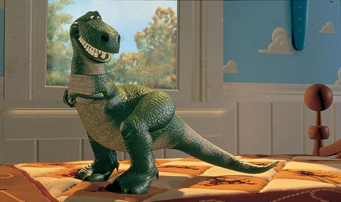 Animated Character Rex standing on Andy's bed