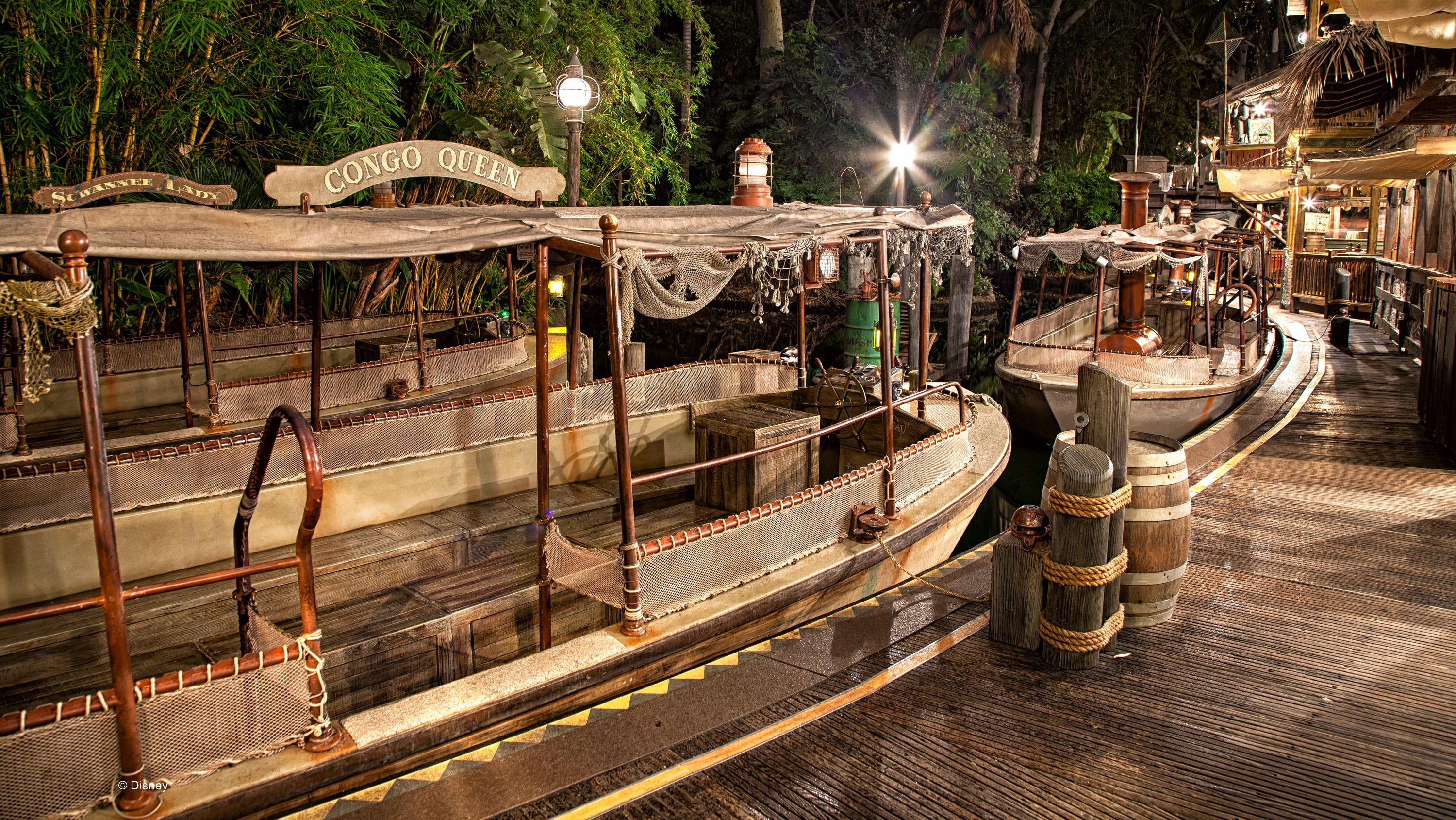 Image of the boat dock and boats from the Jungle Cruise ride.