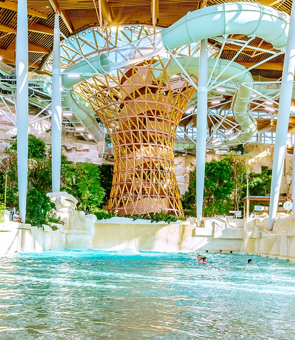 Indoor water park featuring slides and trees at Disneyland Paris