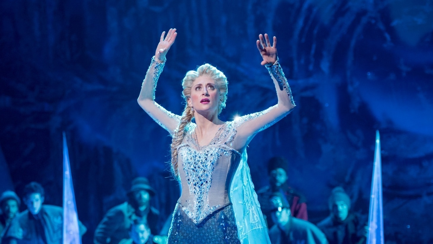 An actress performing on stage in Frozen the Musical