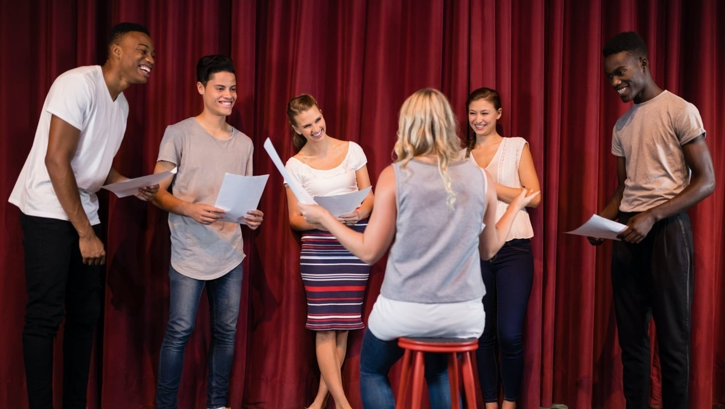 Actors learning a script and rehearsing
