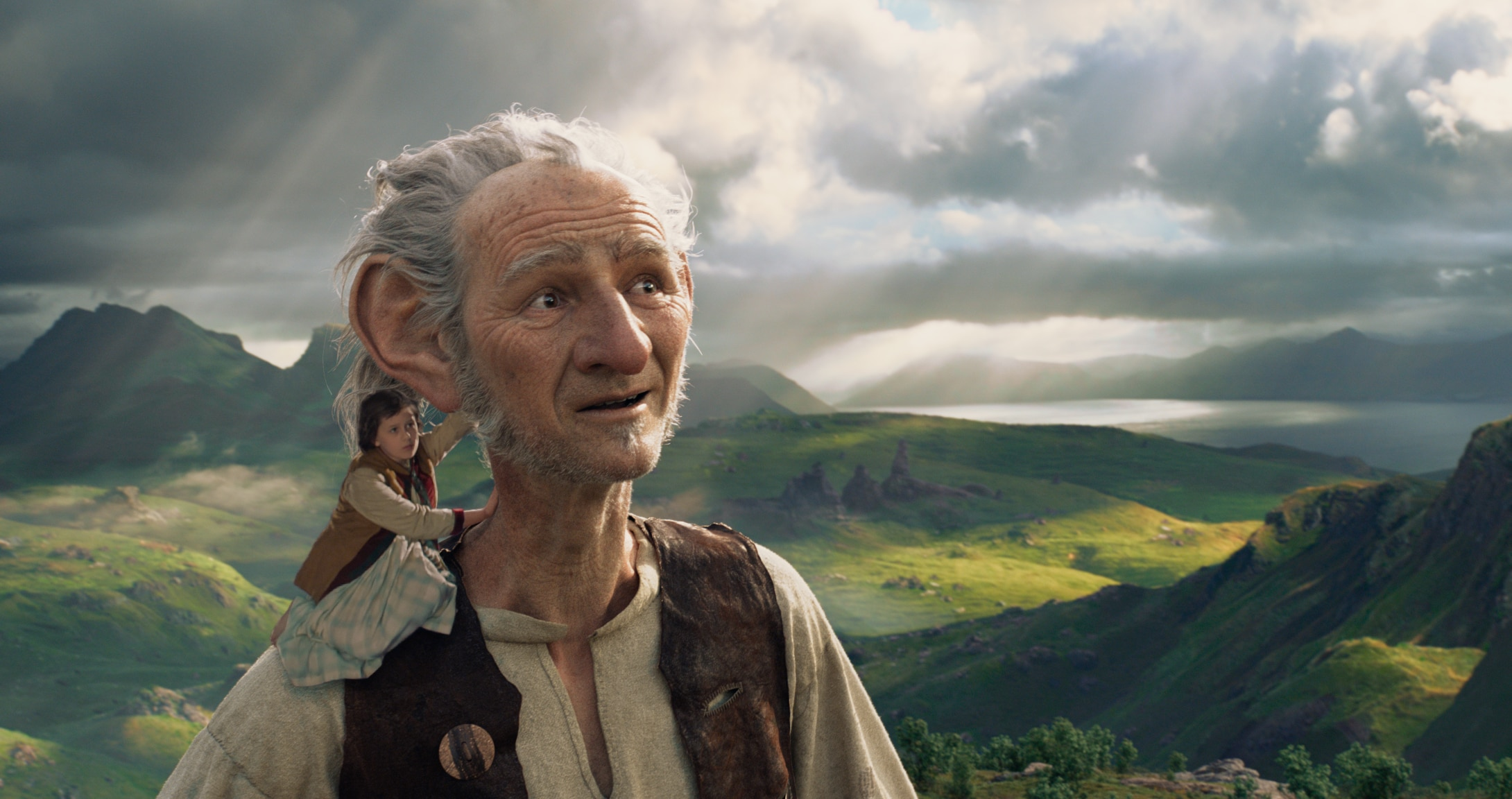 """Ruby Barnhill as Sophie, sitting on the shoulder of The BFG (played by actor Mark Rylance) in the movie """"The BFG"""""""