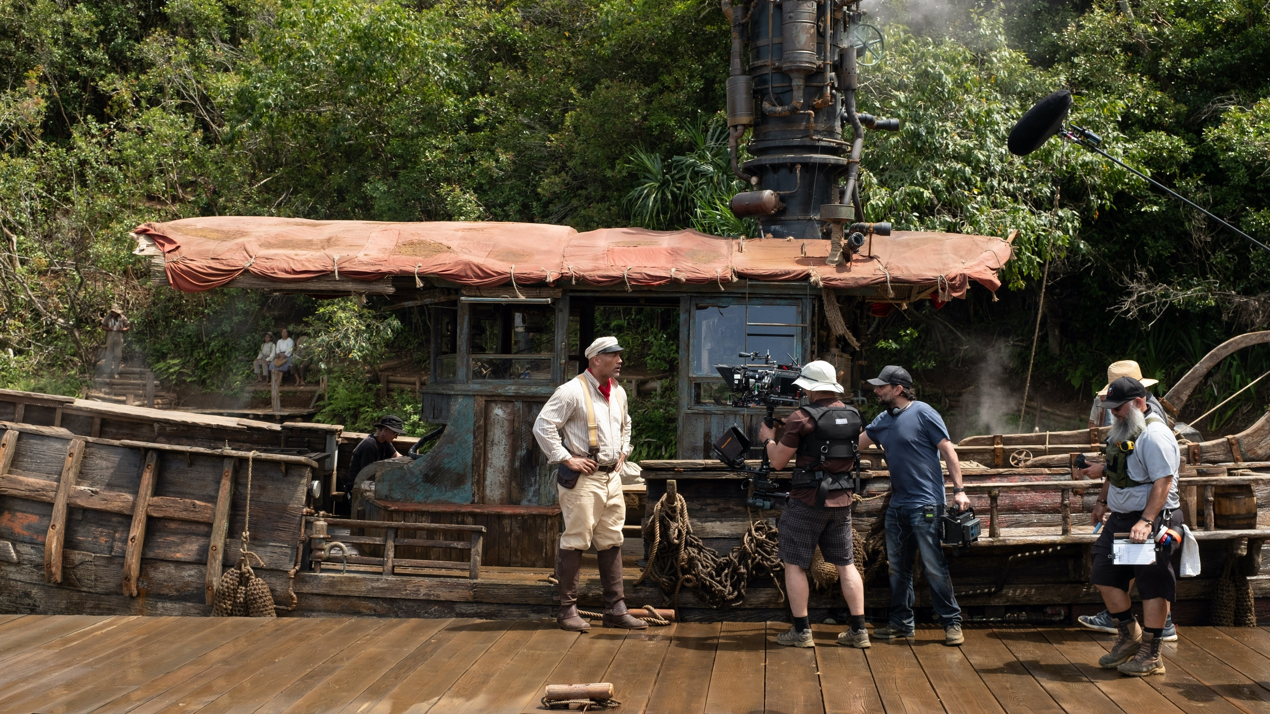 Dwayne Johnson and director Jaume Collet-Serra on the set of Disney's JUNGLE CRUISE. Photo by Frank Masi. © 2021 Disney Enterprises, Inc. All Rights Reserved.