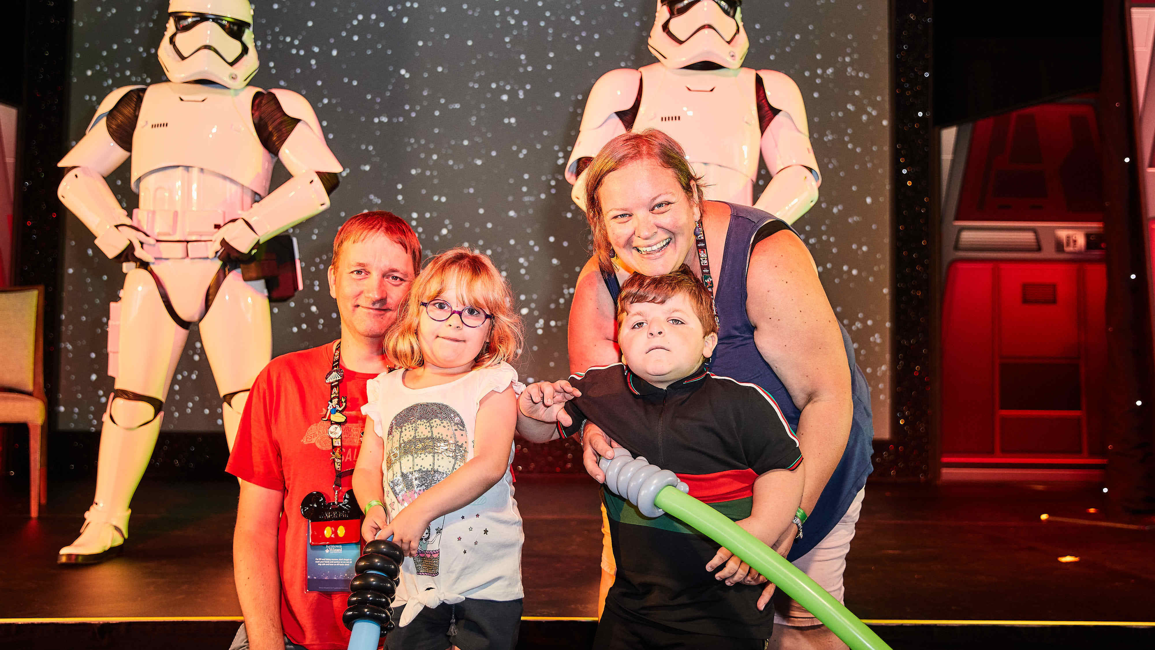 Family pictured with Stormtroopers after the Jedi Experience