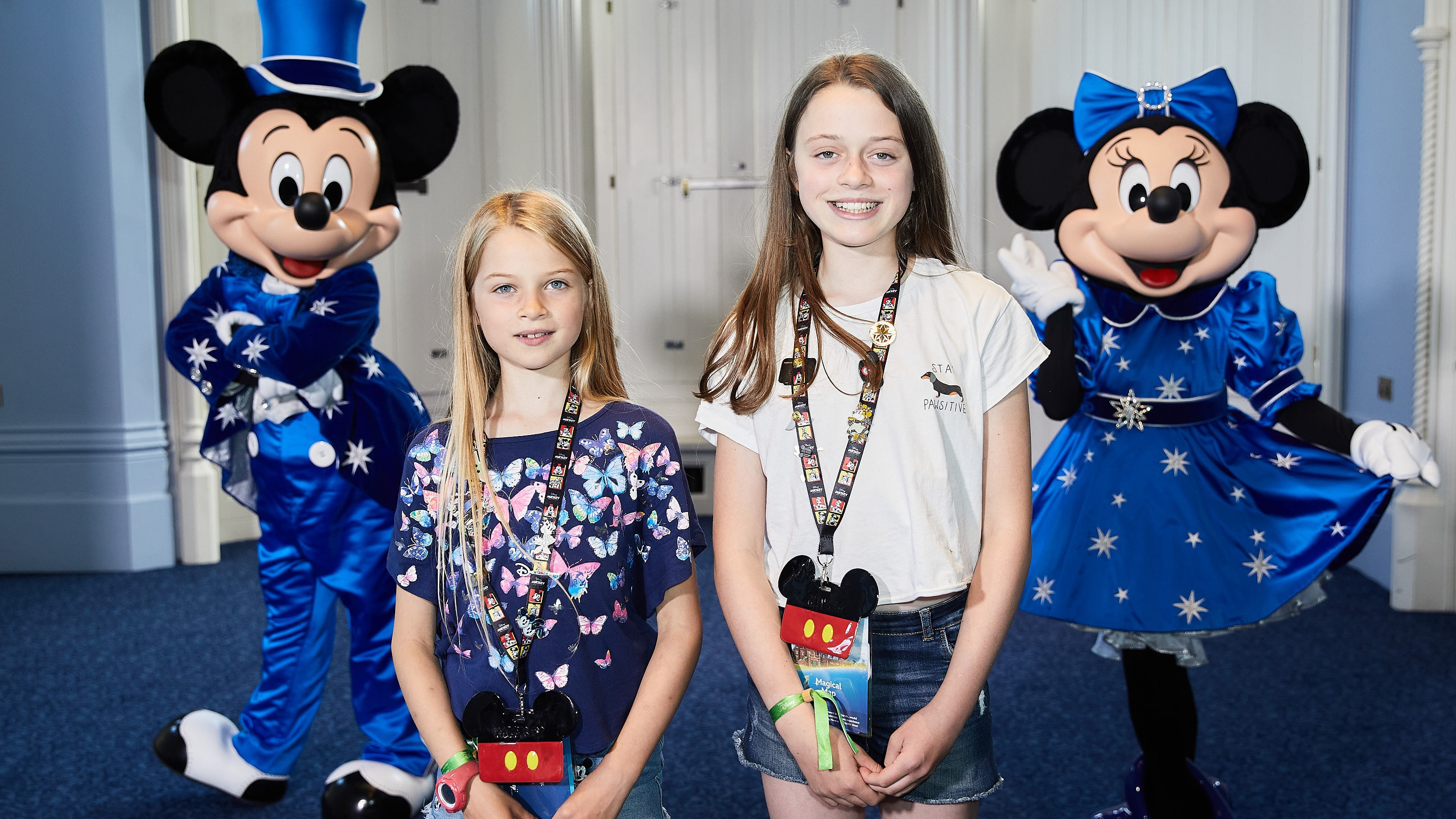 Two girls with Mickey and Minnie Mouse