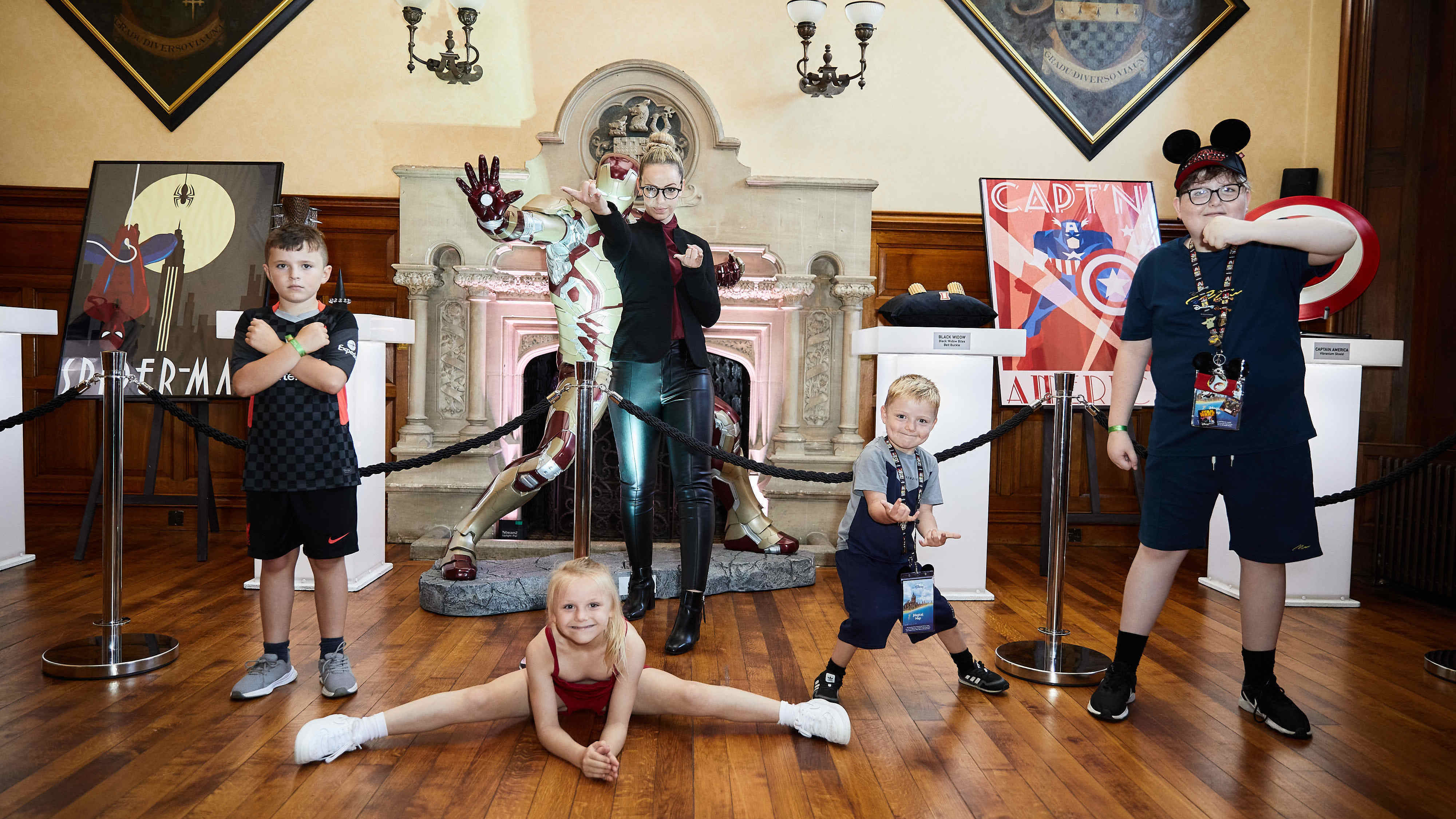 Group picture of children posing with Marvel props