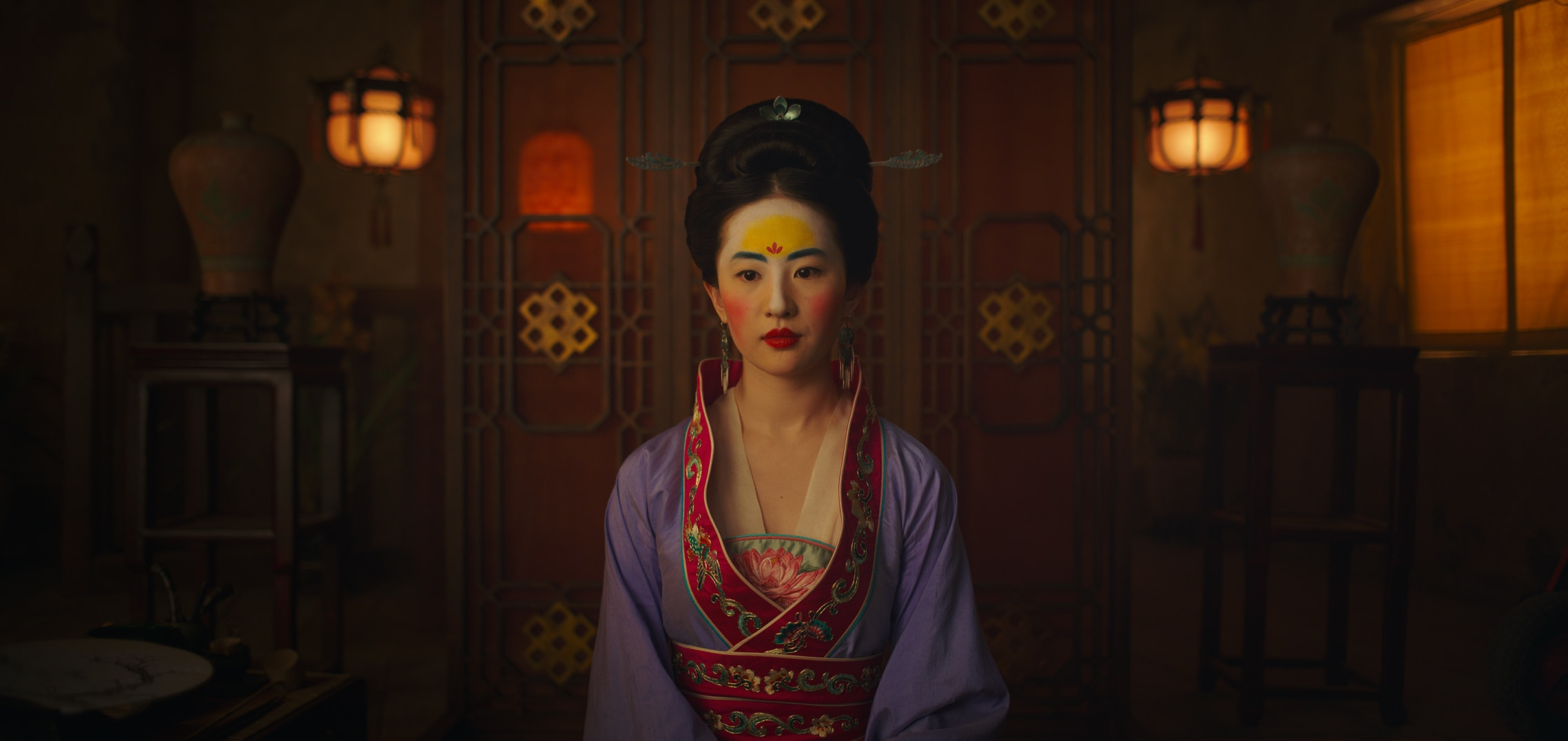 Mulan in make-up and a dress