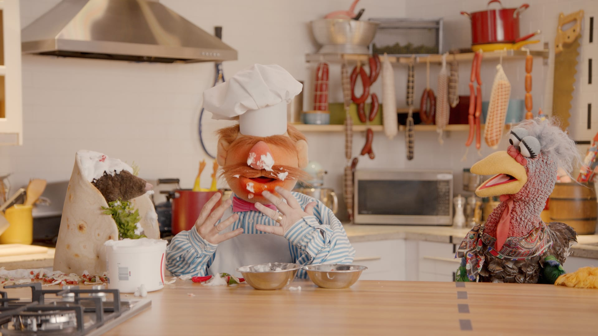 """Swedish Chef and Beverly Plume in """"Muppets Now,"""" streaming on Disney+"""
