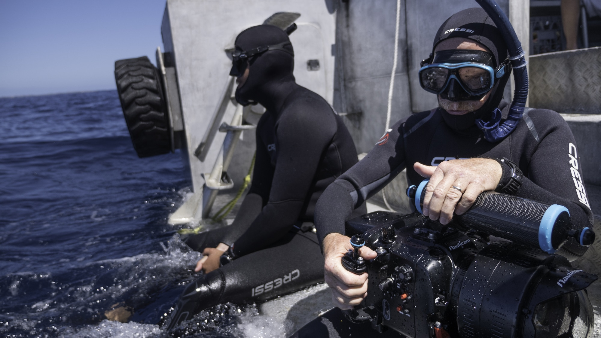 Underwater cinematographer Adam Geiger prepares to dive with humpback whales. (National Geographic for Disney+/Brian Armstrong)