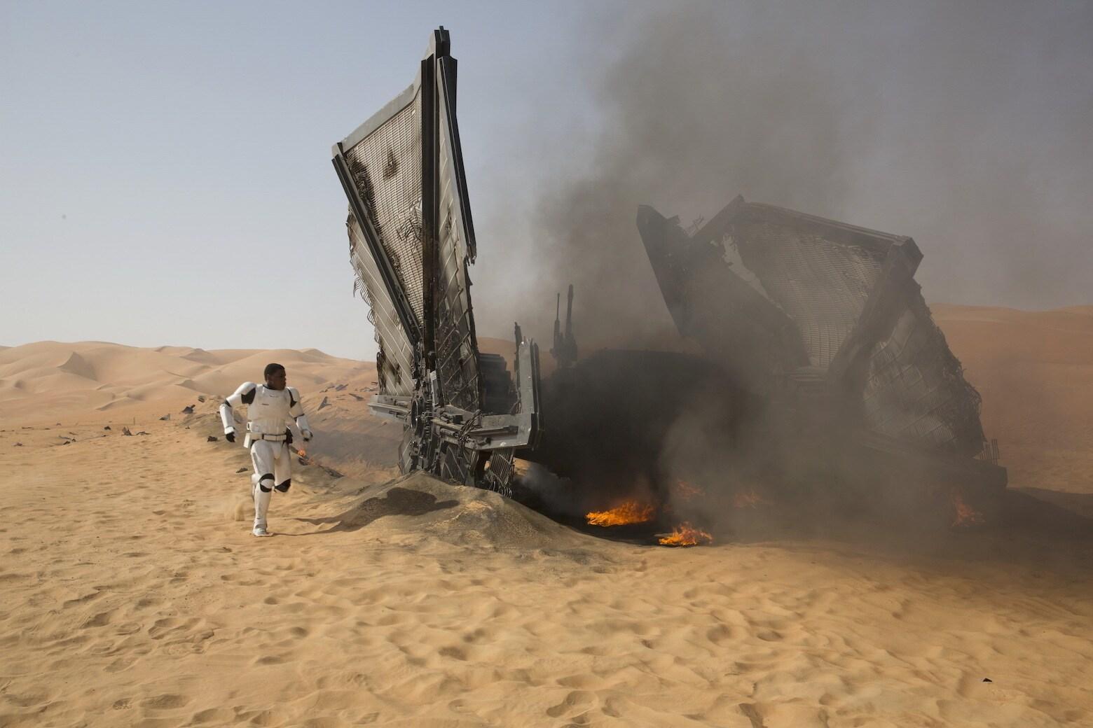 John Boyega Finn arrives at a crashed TIE fighter.