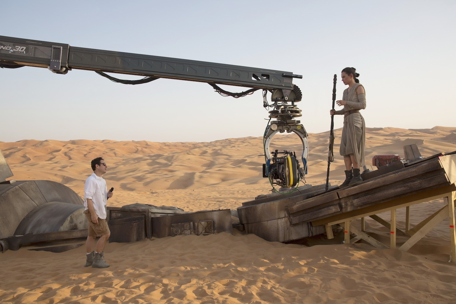 J.J. Abrams directs a scene with Daisy Ridley as Rey.
