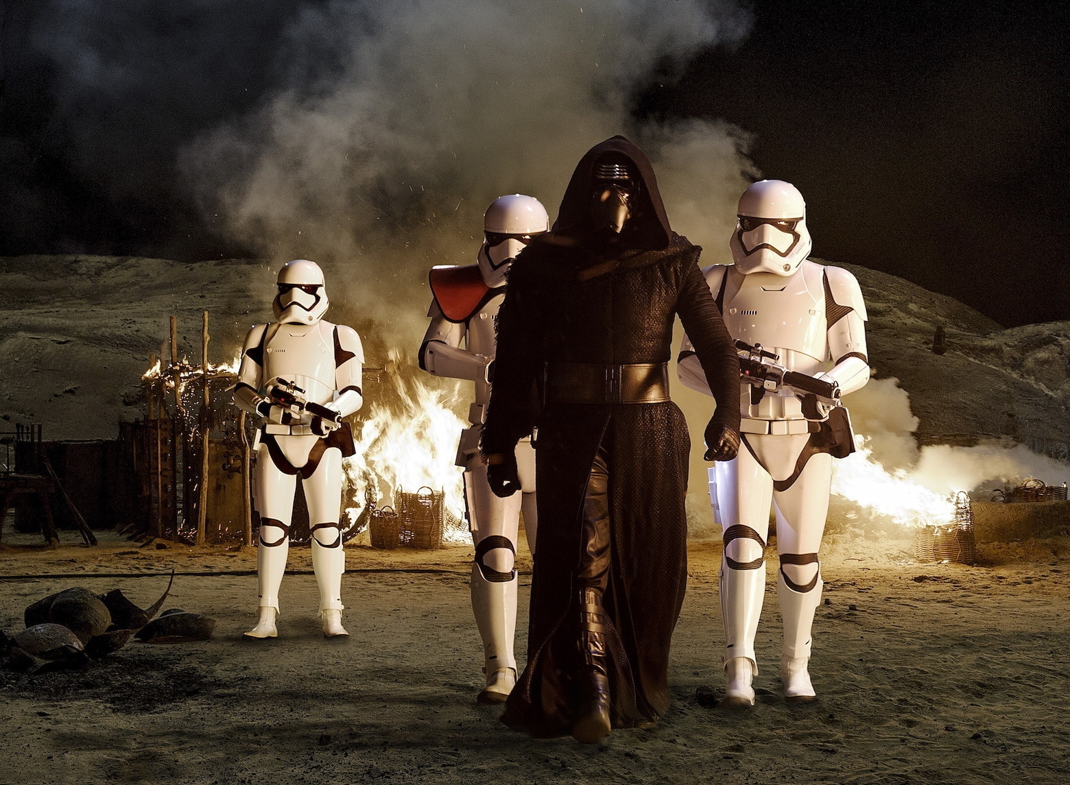 Adam Driver as Kylo Ren leading First Order stormtroopers.