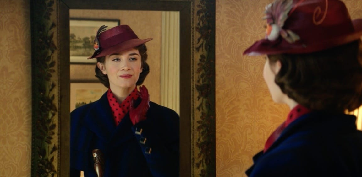 Mary Poppins looking at her reflection in a mirror