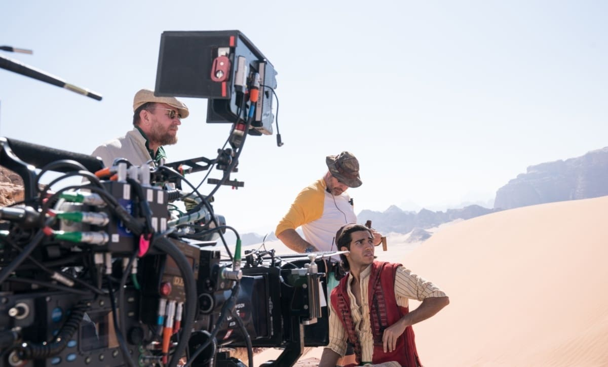 Director Guy Ritchie and Mena Massoud on location in Jordan.
