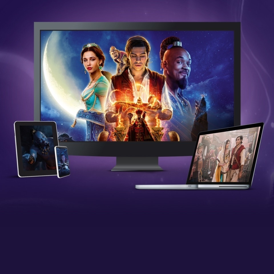 Stills from Aladdin displayed on a TV, laptop, tablet and mobile