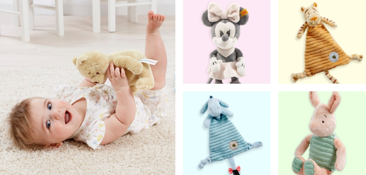 Baby playing with Winnie soft toy, a Minnie soft toy and a Eeyore comforter blanket