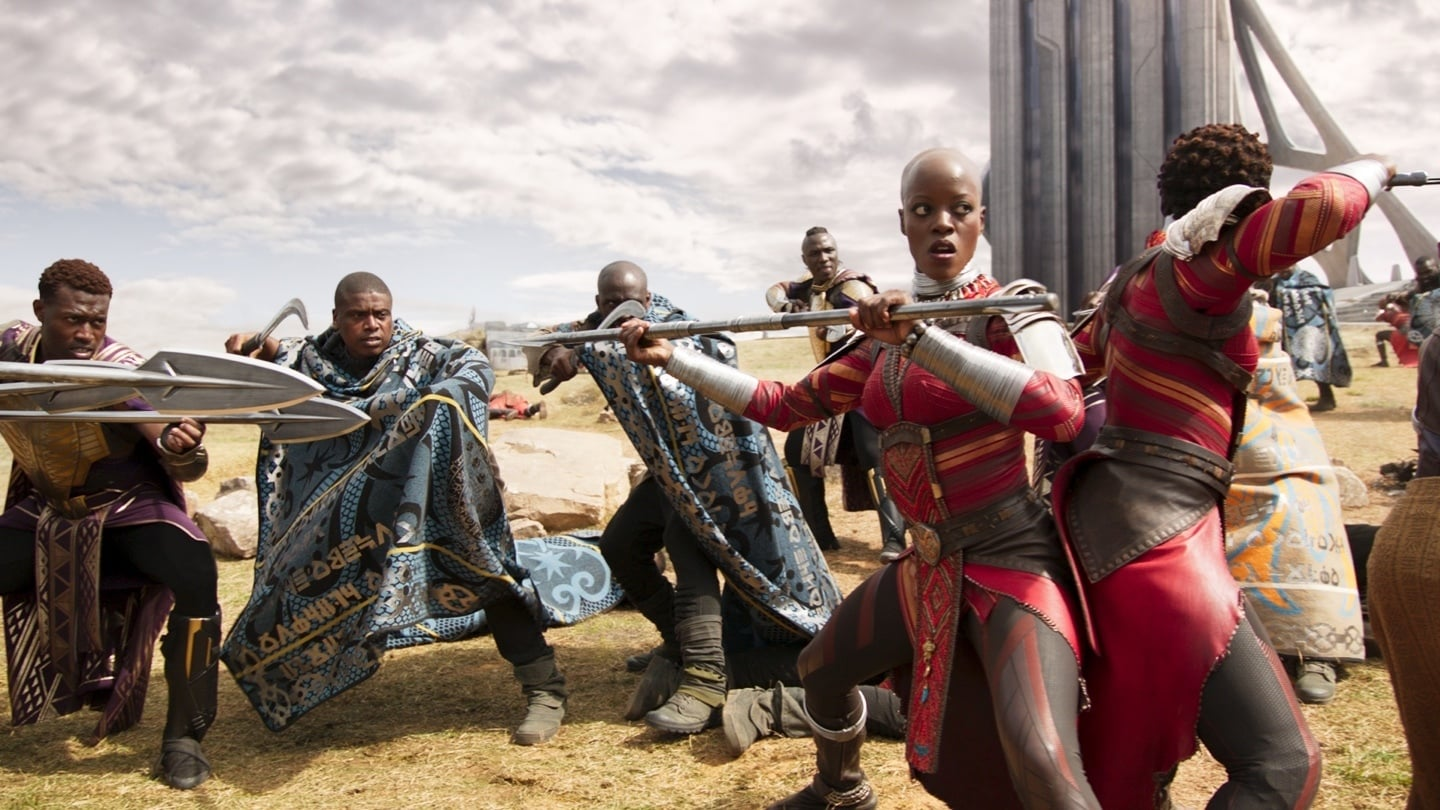 Action shot of Nakia and various characters fighting in Wakanda