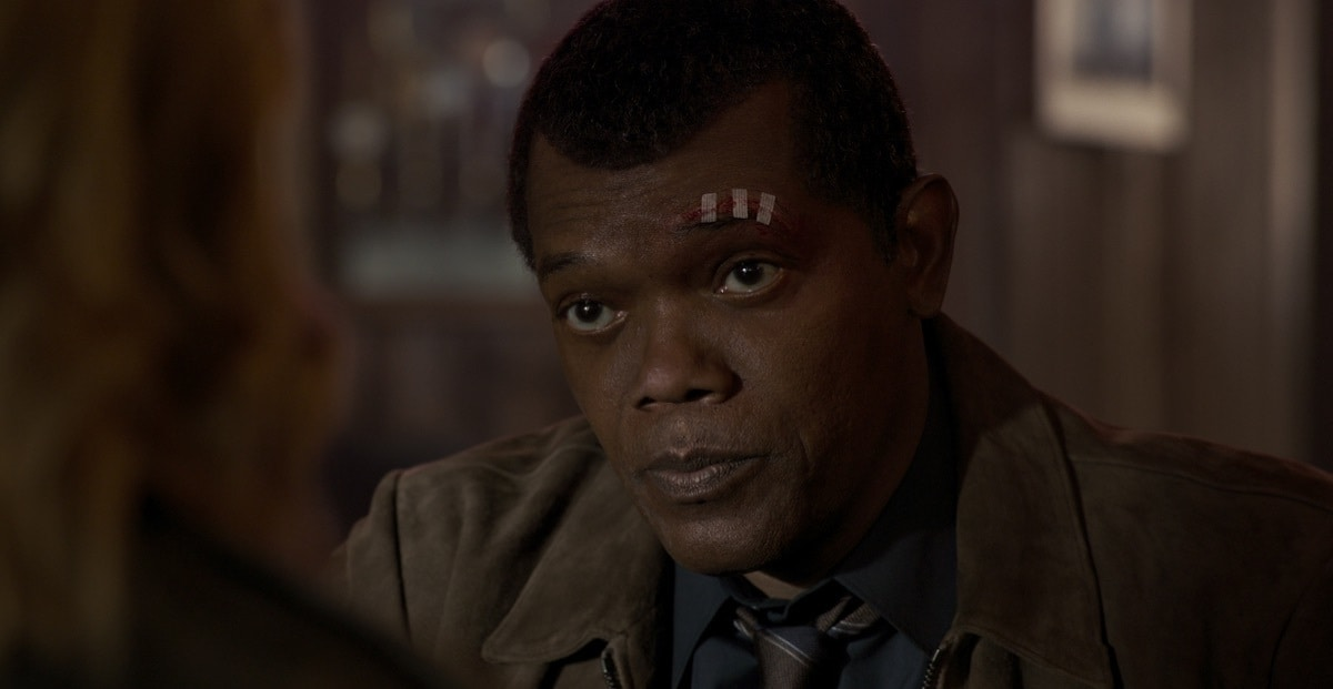 Closeup of Nick Fury with a cut to his eyebrow
