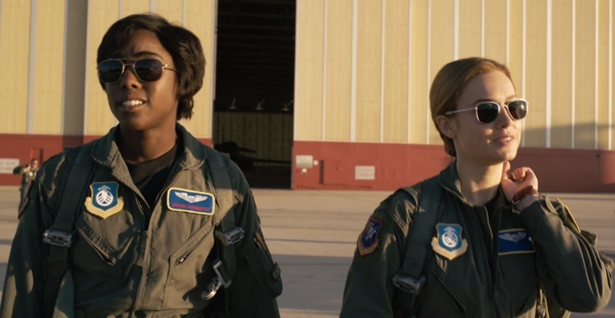 Carol Danvers and Maria Rambeau walking out of an Air Force hangar