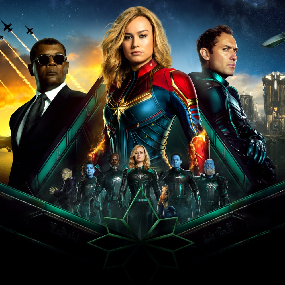 Captain Marvel characters standing in triangular formation