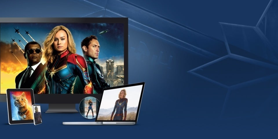Stills from Captain Marvel displayed on a TV, laptop, tablet, mobile and disc