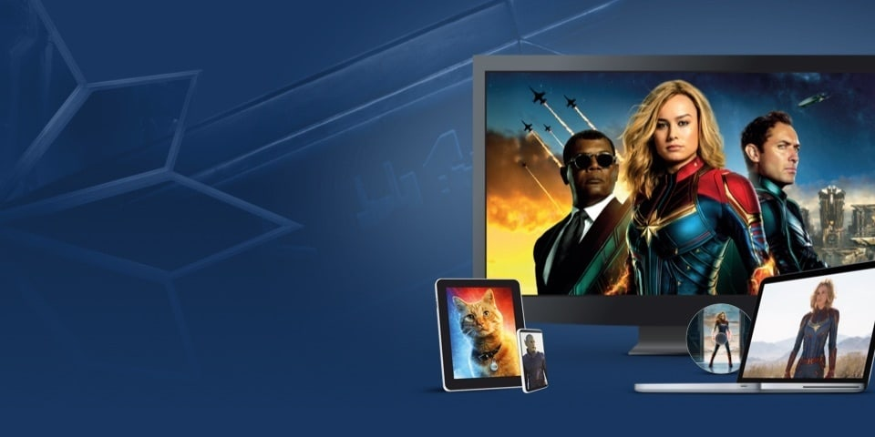 Stills from Captain Marvel displayed on a TV, laptop and various devices