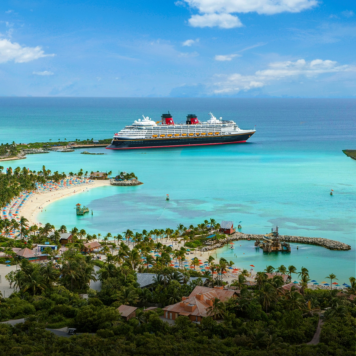 Disney Cruise Ship next to an Island