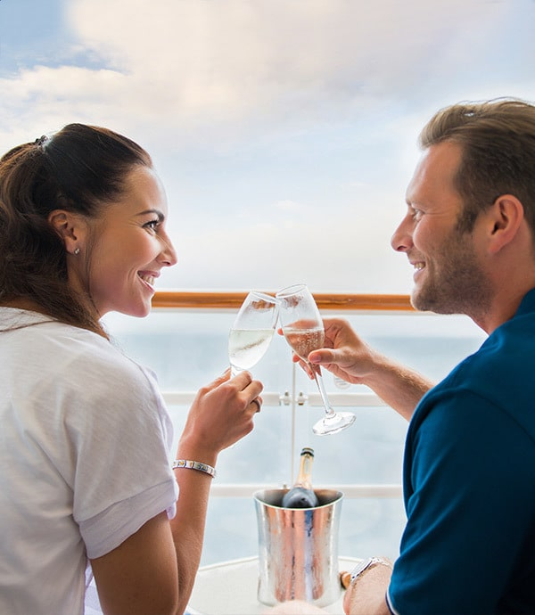 Husband and wife drinking champagne on board a Disney cruise.