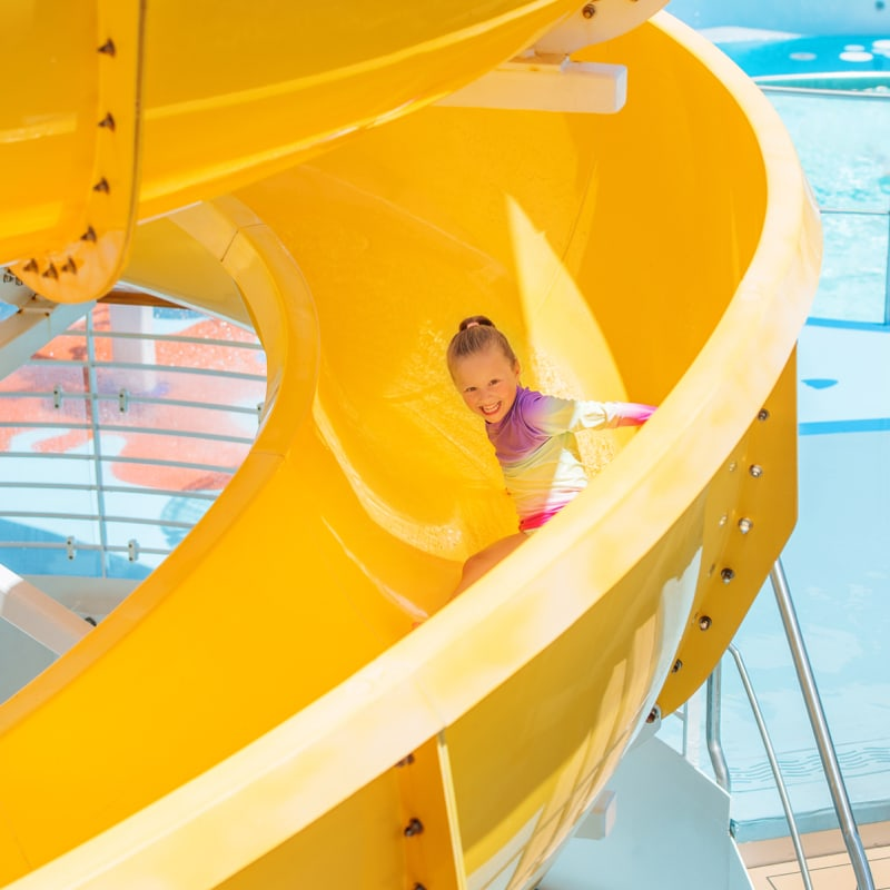 A child going down a water slide