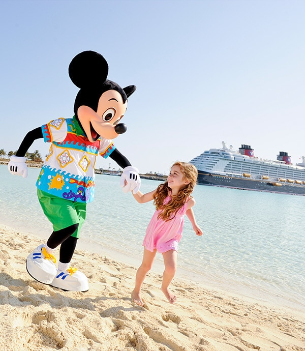 Mickey Mouse and Child on beach with Disney Cruise Ship in the background