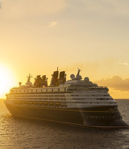 Disney Cruise ship sailing against the sunset