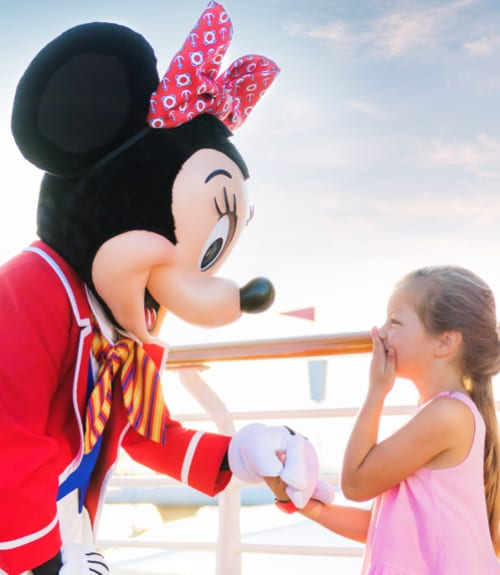 Minnie Mouse laughing with a Child