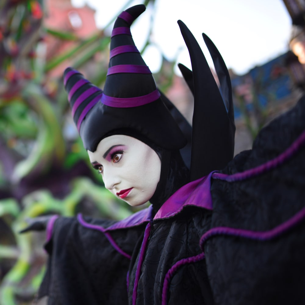 Maleficent standing infront of Sleeping Beauty's castle at Disneyland Paris