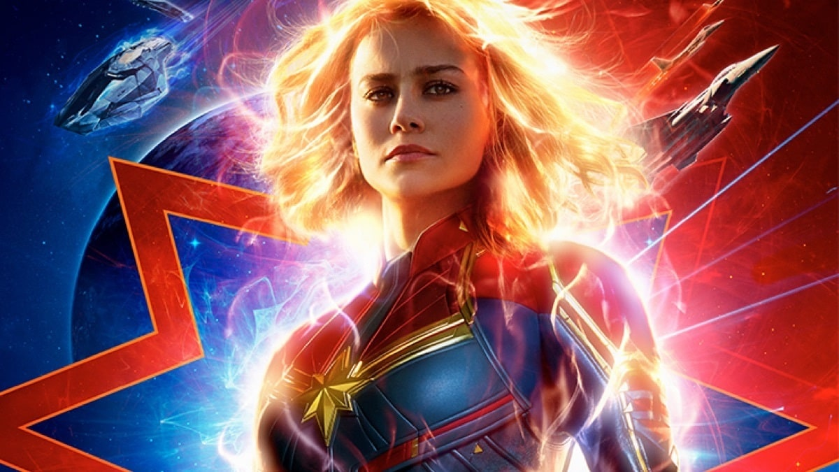 Glowing Captain Marvel with a galactic terrain, space crafts fighter jets in the background