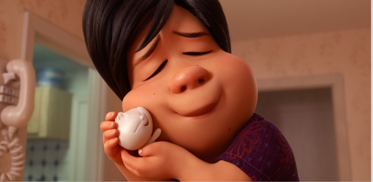Woman smiling and hugging her steamed bun child