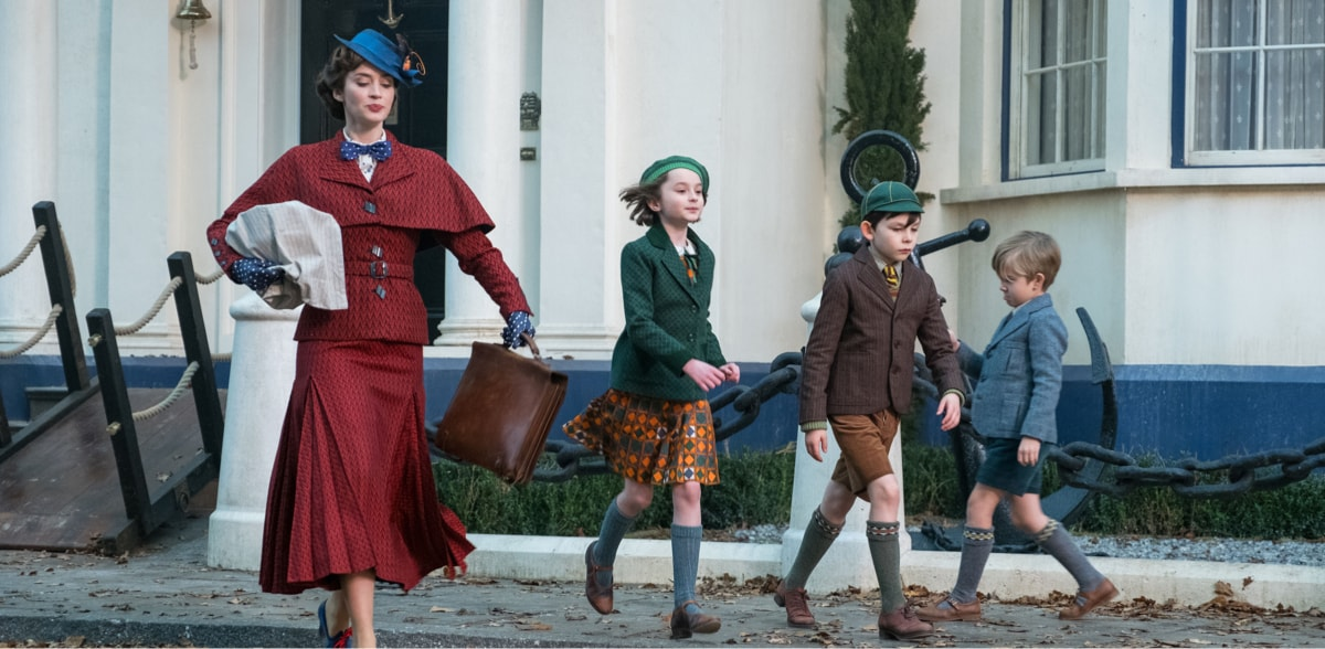Mary Poppins, Annabel, John and Georgie Banks walking down the street