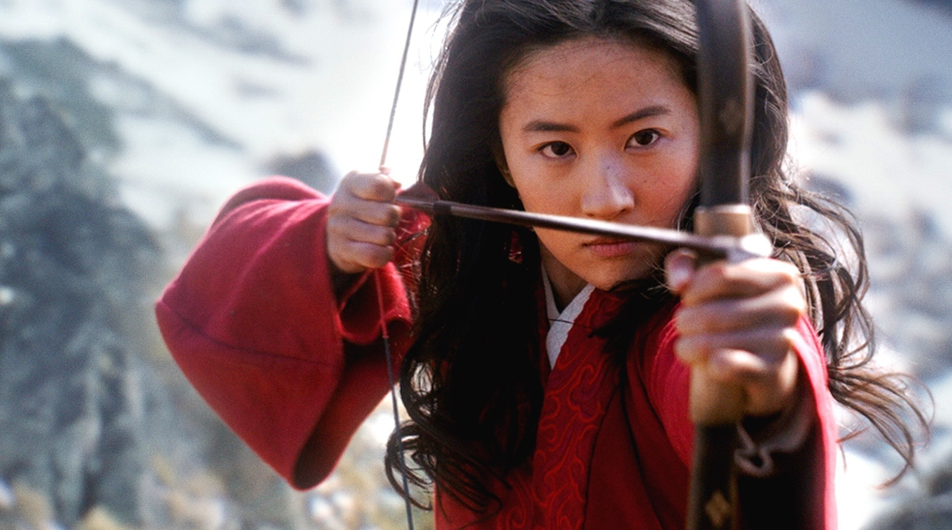 A still image of Mulan holding a bow and arrow