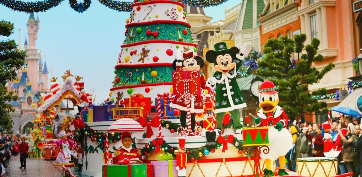 minnie donald and friends glide down main street disneys christmas parade features floats covered with festive decorations and accompanied by dancing