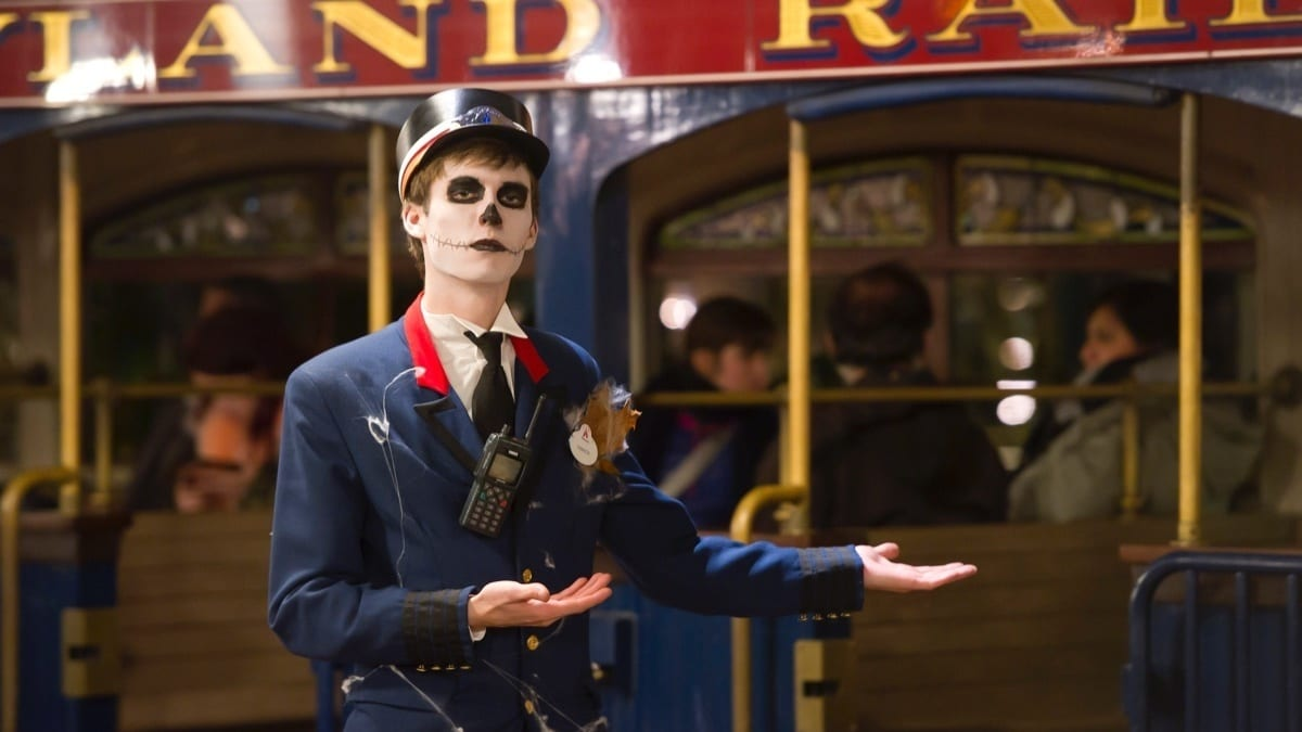 Man dressed as a skeleton train conductor